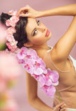 Brunette beautie with the spring flowers stock images