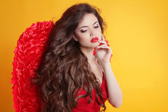 Brunette Beautiful Angel Girl model with wavy long hair isolated Royalty Free Stock Image