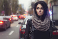 Brunette beautiful caucasian woman in scarf on a european city s Stock Photography