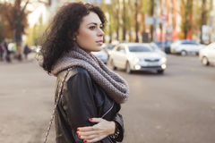 Brunette beautiful caucasian woman in scarf on a european city s Stock Photos