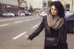 Brunette beautiful caucasian woman in scarf on a european city s Stock Image