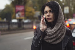 Brunette beautiful caucasian woman in scarf on a european city s Royalty Free Stock Photos