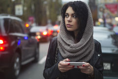 Brunette beautiful caucasian woman in scarf on a european city s Stock Images