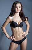 Brunette beautiful girl posing in black lingerie Royalty Free Stock Images