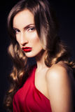 Brunette beautiful luxury woman in red dress with clear skin and Stock Photos