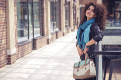 Brunette beautiful stylish caucasian woman in casual outfit on a Royalty Free Stock Images