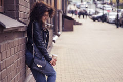 Brunette beautiful stylish caucasian woman in casual outfit on a Royalty Free Stock Photo