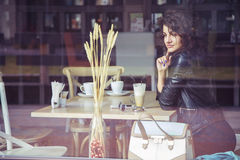 Brunette beautiful stylish caucasian woman in casual outfit on a Royalty Free Stock Photography
