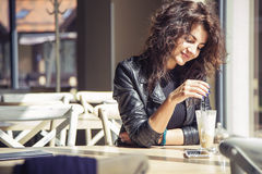 Brunette beautiful stylish caucasian woman in casual outfit on a Stock Photos