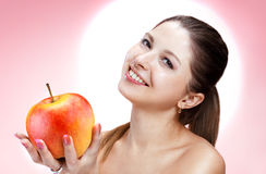 Brunette beautiful woman with apple Stock Photos