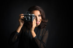 Brunette  beautiful woman taking a photo  vintage camera Stock Image