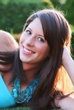Brunette beauty. Beautiful teenage girl, outside, backlit by the setting sun Royalty Free Stock Photography