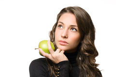 Brunette beauty with apple. Stock Image