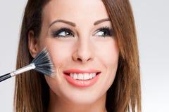 Brunette Beauty Applying Makeup. Stock Image
