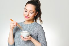 Brunette beauty with asian food. Royalty Free Stock Photos