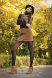 Brunette beauty in autumn clothes. Stock Photo
