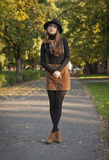 Brunette beauty in autumn clothes. Royalty Free Stock Photo