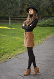 Brunette beauty in autumn clothes. Stock Image