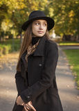 Brunette beauty in autumn clothes. Stock Photos