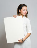 Brunette beauty with blank banner. Royalty Free Stock Photos