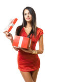 Brunette beauty with bright red gift box. Royalty Free Stock Photography