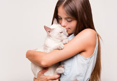 Brunette beauty with cat. Stock Photography