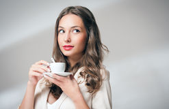 Brunette beauty with coffee. Stock Images