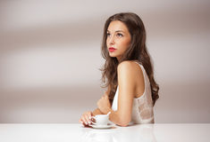 Brunette beauty with coffee. Stock Photo