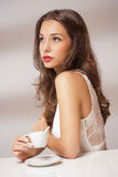 Brunette beauty with coffee. Stock Photography