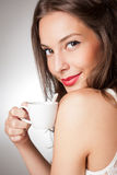 Brunette beauty with coffee. Royalty Free Stock Photos