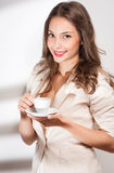 Brunette beauty with coffee. Royalty Free Stock Photo