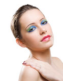 Brunette beauty in colorful makeup. Stock Photo