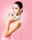 Brunette beauty enjoying music. Royalty Free Stock Photos