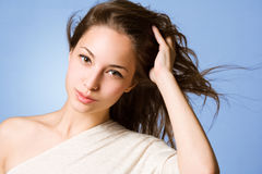 Brunette beauty with flowing hair. Royalty Free Stock Photography