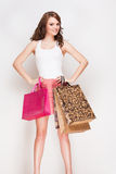 Brunette beauty goes shopping. Stock Photography