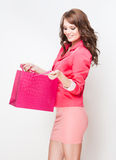 Brunette beauty goes shopping. Royalty Free Stock Photography