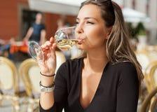 Brunette beauty having wine fun. Royalty Free Stock Images