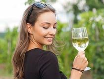 Brunette beauty having wine fun. Royalty Free Stock Photo