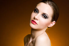 Brunette beauty in heavy makeup. Stock Images