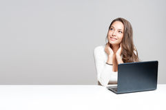 Brunette beauty with her laptop. Stock Photos