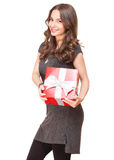 Brunette beauty holding gift box. Royalty Free Stock Images