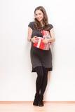 Brunette beauty holding gift box. Stock Photography