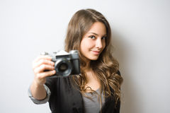 Brunette beauty holding vintage camera. Stock Photos