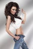 Brunette beauty in jeans. Stock Photo
