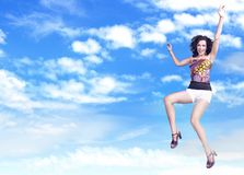 Brunette beauty jumping stock images