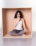 Model asks for silence - trapped in box concept Stock Photos