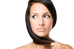 Brunette beauty with shiny healthy hair. Royalty Free Stock Image