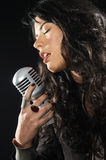 Brunette beauty singing with retro mic Royalty Free Stock Photo