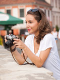 Brunette beauty taking photo. Royalty Free Stock Images