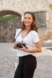 Brunette beauty taking photo. Stock Photo